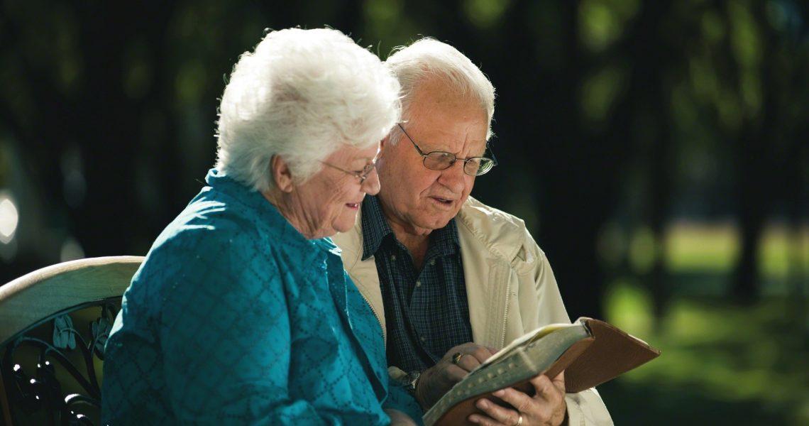 elderly-mormon-couple-studying-scriptures-501484-wallpaper