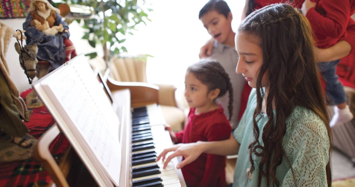 family_playing_piano-min