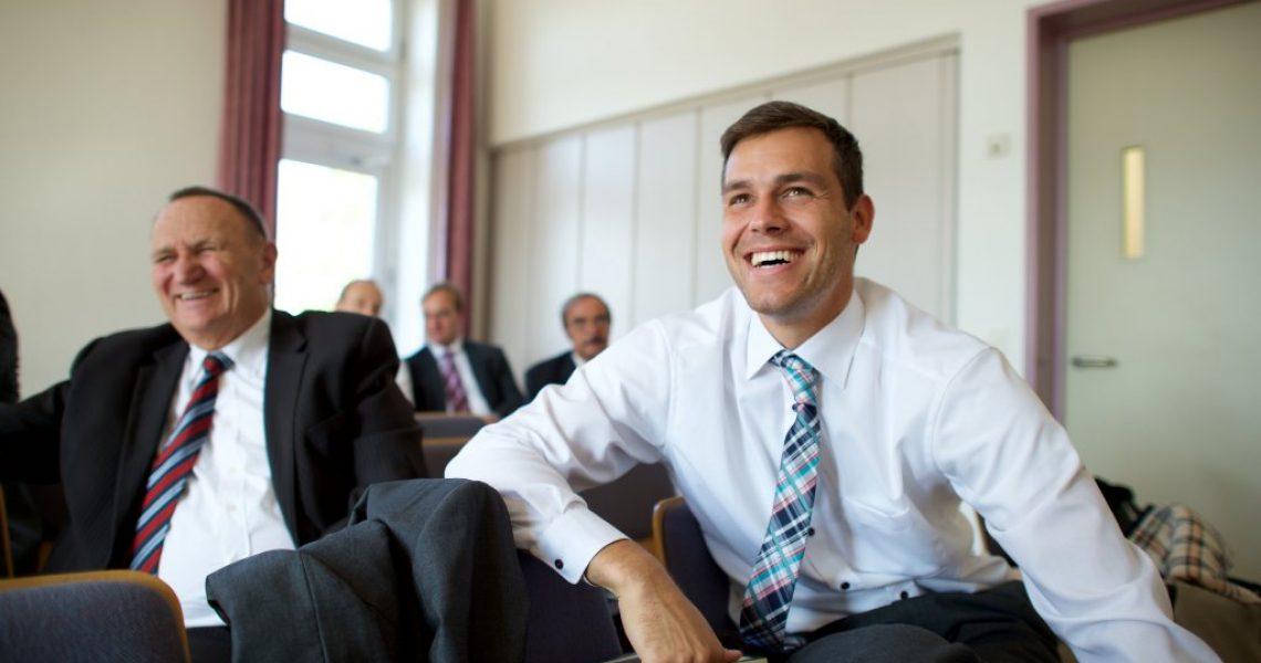 Men sit during elders quorum in Germany.   LDS.org