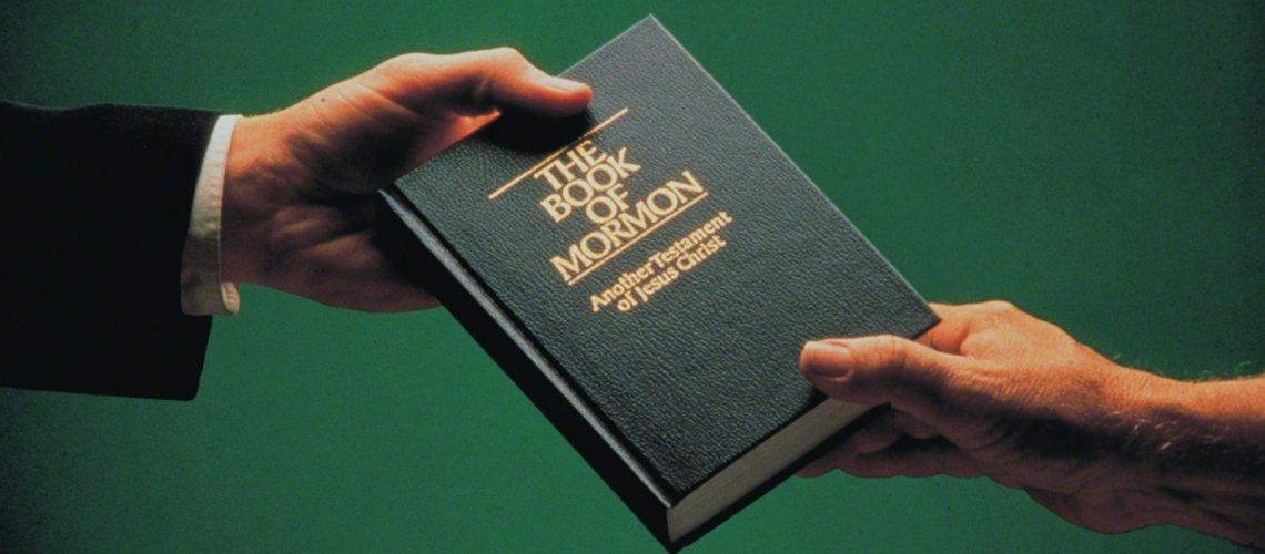 man-giving-book-of-mormon-225221-print