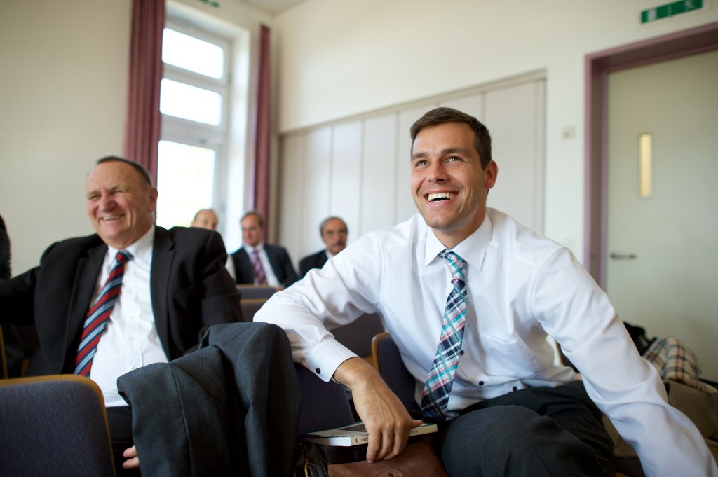 Men sit during elders quorum in Germany. | LDS.org